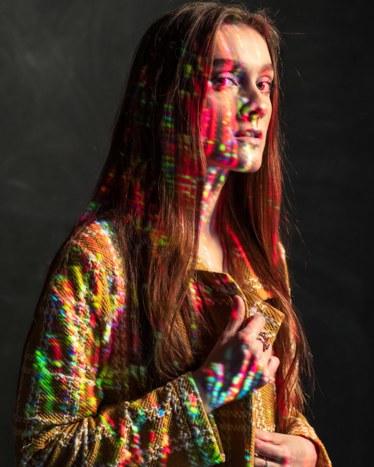 Creative portrait with color projection on face